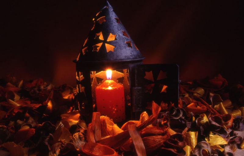 Burning Candle In Lantern