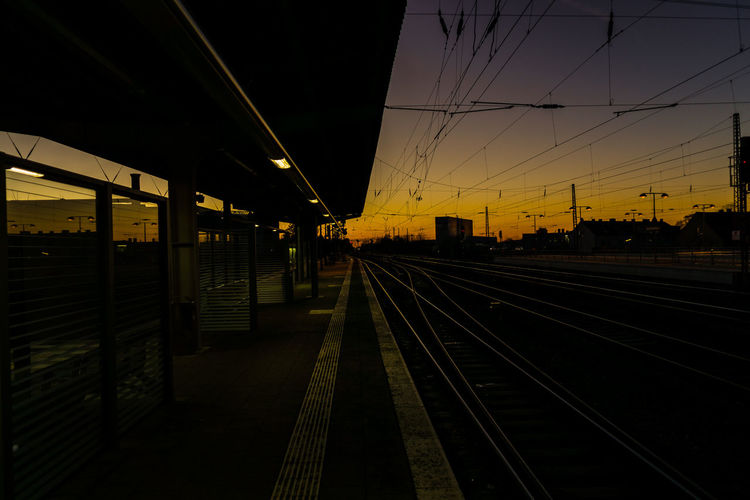 Wanderlust. 19mm 19mm/f2.8 Architecture Available Light Built Structure City Dusk Low Light Night Nightfall No People Outdoors Public Transportation Rail Transportation Railroad Station Railroad Station Platform Railroad Track Railway Railway Station Sky Sunset Train Station Transportation