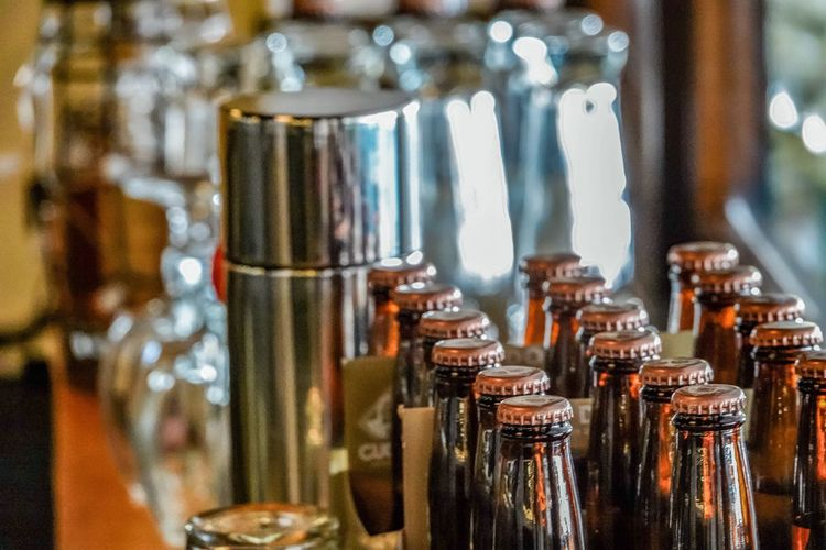 Close-up of beer and stainless steel glass