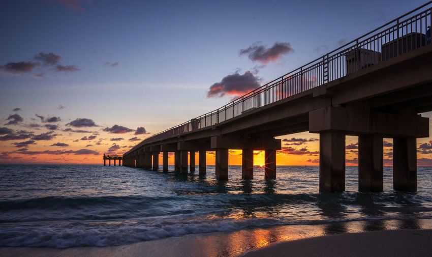 Sunrise at Sunny Isles beach, Miami Sky Built Structure Water Architecture Sea Cloud - Sky Scenics - Nature No People Beauty In Nature Motion Sunny Isles Beach Jetty Pier Sun Set Sunrise Morning Seascape Landscape Ocean Low Angle View Tranquil Scene Beach