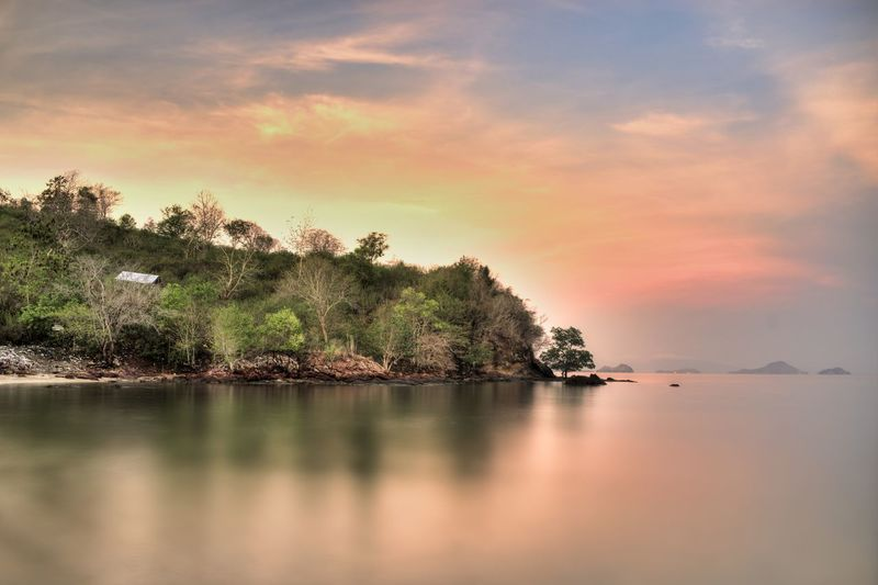 Sunrise at Labun bajo, Flores, Indonesia Flores Labuan Bajo Sunrise Sunrise_sunsets_aroundworld INDONESIA Water Tranquility Tranquil Scene Beauty In Nature Tree Sky Scenics - Nature Sunset Waterfront Cloud - Sky Plant Nature Reflection No People Lake Idyllic Non-urban Scene Outdoors Land