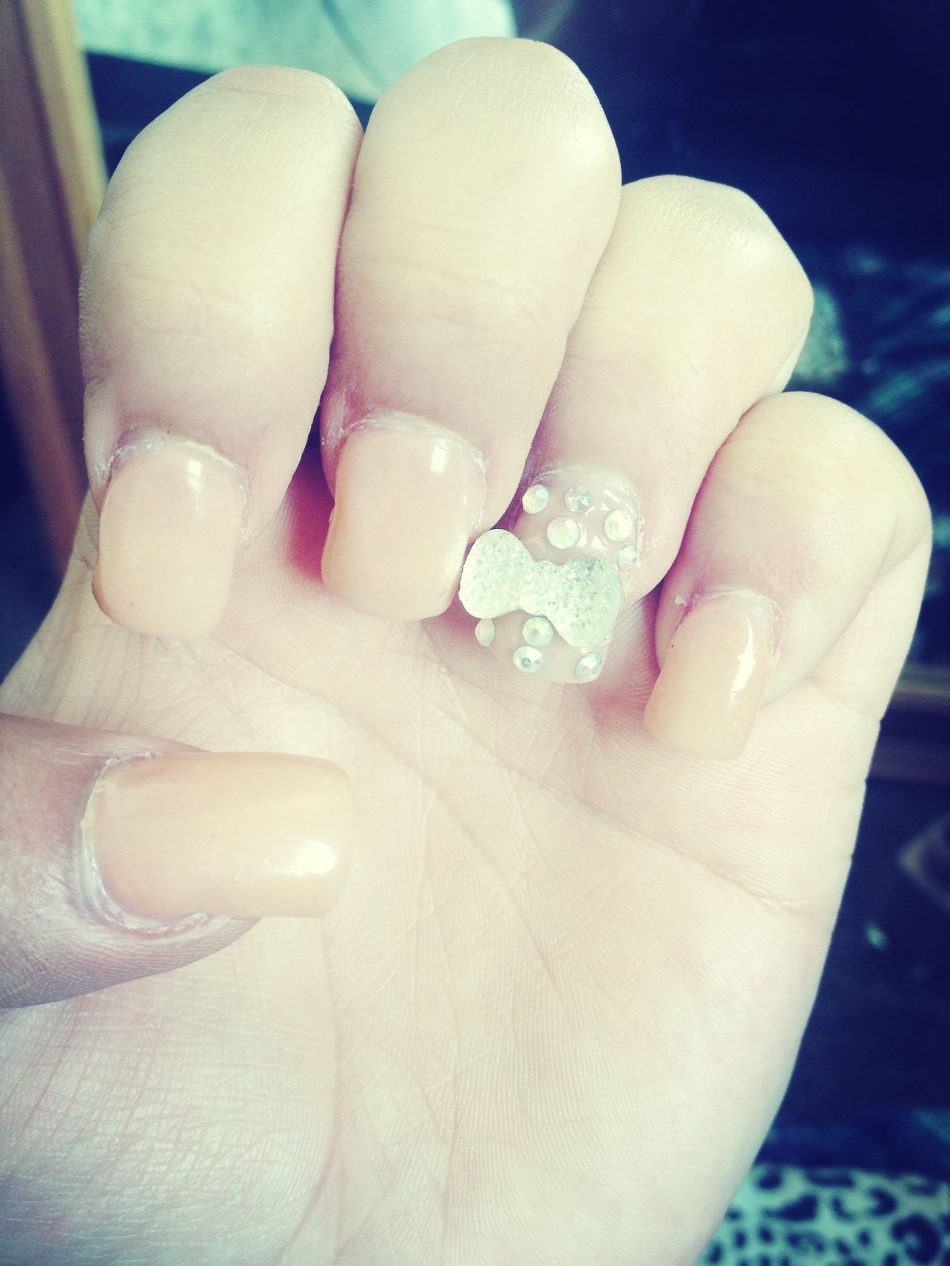 person, part of, human finger, close-up, cropped, holding, indoors, personal perspective, unrecognizable person, ring, showing, nail polish, focus on foreground, palm, lifestyles