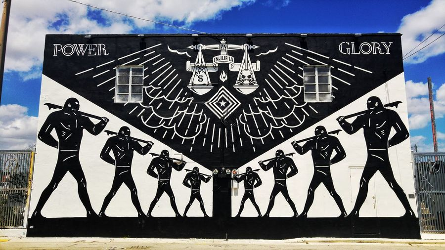 Astonishing street art by Obey Giant Full Length Outdoors Day Mural Art Wynwood Art Walk Wynwood Miami Miami Miami Living Obey Giant Artistic Expression Black And White Power Glory City Travel