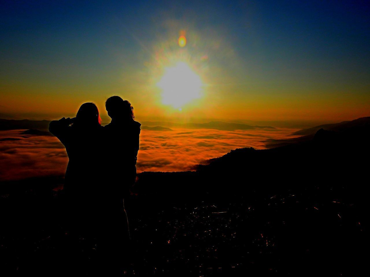 sunset, silhouette, sky, real people, orange color, leisure activity, nature, bonding, beauty in nature, lifestyles, togetherness, love, men, two people, positive emotion, people, standing, women, tranquility, tranquil scene, outdoors, couple - relationship, sun