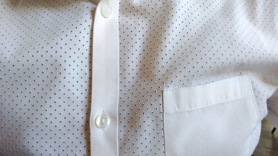 Close-Up Of White Button Down Shirt