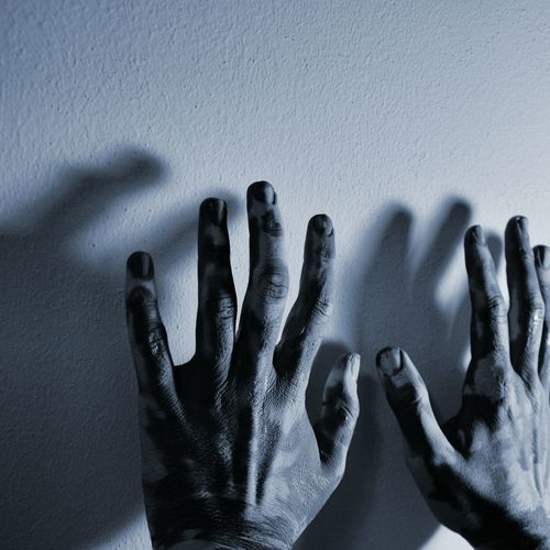 Cropped hands against white wall