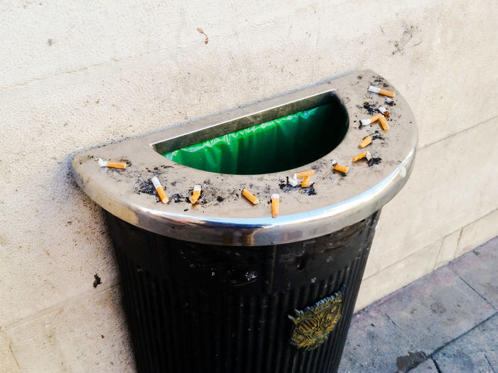 Close-up of cigarette on wall