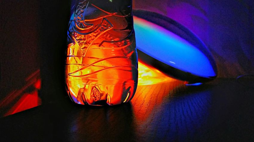 Water bottle woth noise :P Water Waterbottle Night Nightphotography Nightshot Light And Shadow Night Lights Close-up Mystery Textile Indoors  Hanging Clothing Ideas Multi Colored Creativity Blue Dark Vibrant Color