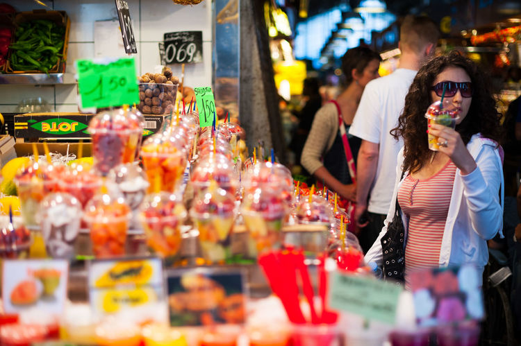market of fruits in Barcelona Market Adult Business Buying Choice Consumerism Food Food And Drink Glasses Leisure Activity Lifestyles Market Market Stall Men People Real People Retail  Selective Focus Shopping Variation Women Young Adult