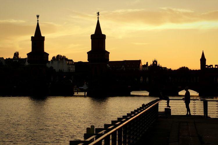 Oberbaum Bridge Over Spree River Against Sky At Sunset