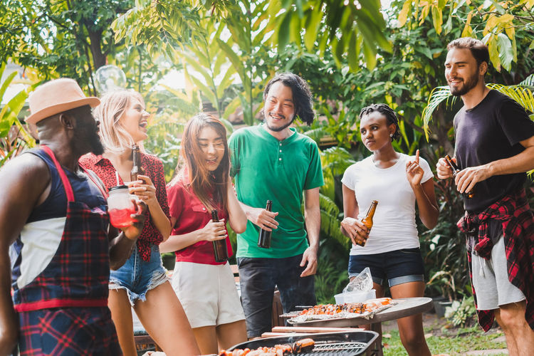 Group of people having food on barbecue