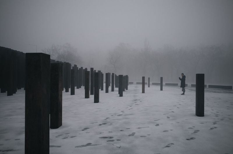 Panoramic view of cemetery against sky during winter