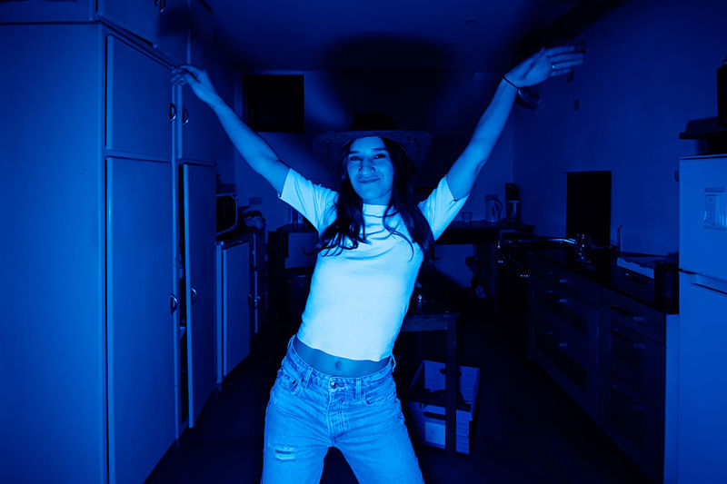 Young woman dancing in the kitchen arty