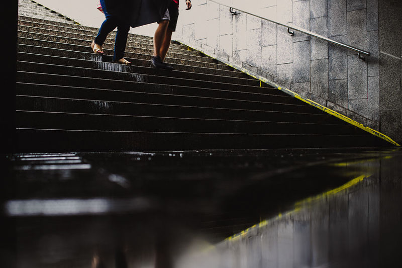 Capture The Moment Rain The Week on EyeEm Architecture Body Part Built Structure Canonphotography Human Body Part Human Foot Human Leg Human Limb Leisure Activity Lifestyles Light And Shadow Low Section One Person Outdoors Railing Real People Reflection Staircase Steps And Staircases Streetphotography Unrecognizable Person Walking Water Women