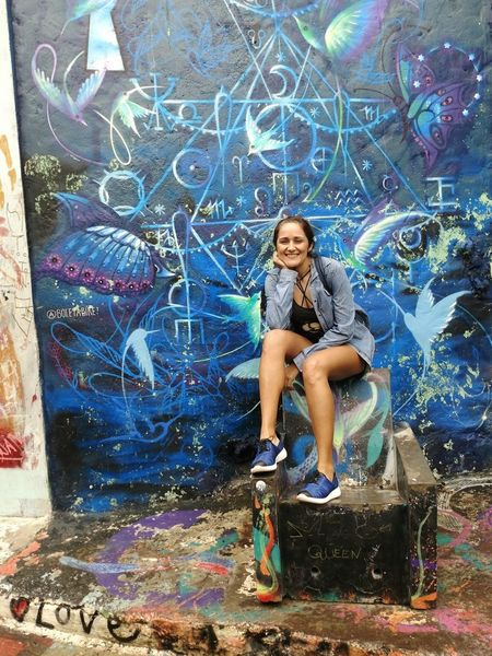Throne Graffiti Full Length Art And Craft One Person Multi Colored Blue Outdoors Real People Architecture People Adult Young Women Young Adult Con6 Fun Women Connected By Travel Brasil ♥ Day Happiness Smiling Casual Clothing Travel Destinations Sunlight Only Women
