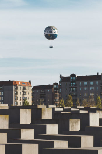Architecture Built Structure Building Exterior Sky Flying Nature Building Day Mid-air Transportation Balloon City No People Outdoors Air Vehicle Cloud - Sky Residential District Sunlight Mode Of Transportation Cityscape Berlin My Best Photo 17.62°