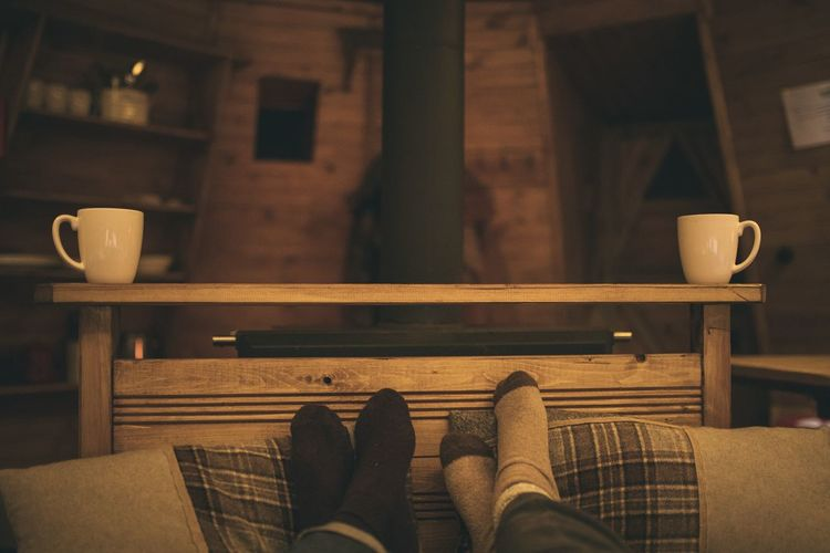 Low section of people relaxing at home