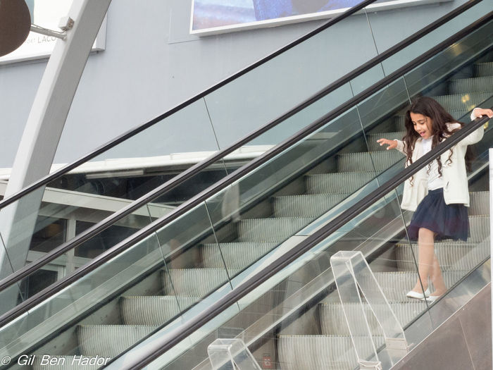 A girl is going down the upstairs in the shopping center City Day Down The Upstairs Girl Playing One Girl Only Shopping Center Steps Steps And Staircases Young Girl EyeEmNewHere