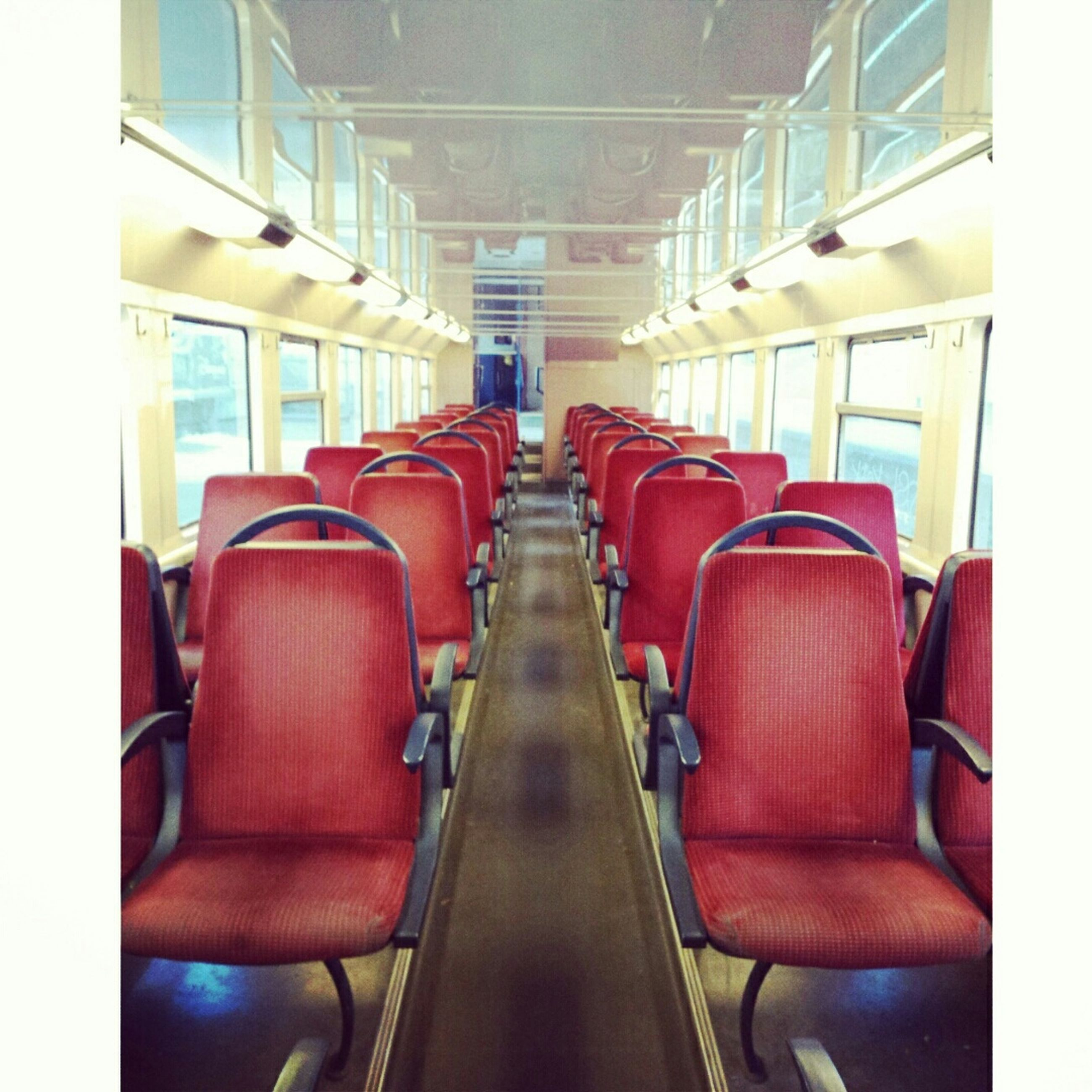 indoors, transportation, vehicle seat, mode of transport, empty, absence, chair, seat, vehicle interior, in a row, land vehicle, window, public transportation, travel, bus, train - vehicle, no people, train, day, interior