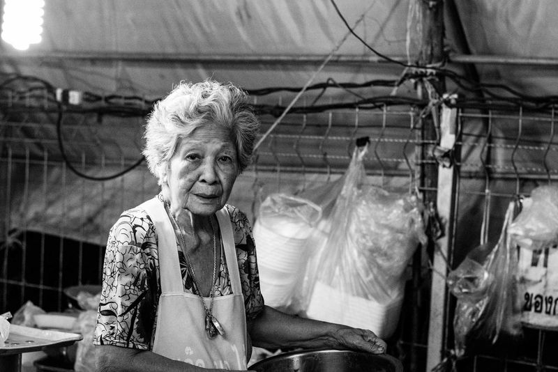 Cooking Nightphotography Adult Adults Only Black And White Day Night Market Night Market In Thailand One Person One Senior Woman Only One Woman Only Only Women Outdoors People Portrait Real People Senior Adult Senior Women