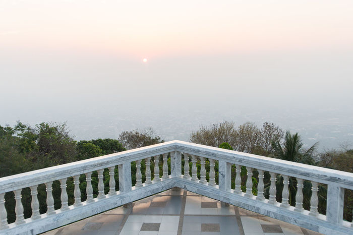 Smoke Cold Temperature Day Fog Foggy Nature No People Outdoors Railing Sky Smog Sun Sunrise Tree Winter