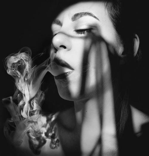 Shadows & Lights Smoke Addiction Close-up Front View One Person People Real People Smoking - Activity Young Adult Young Women The Portraitist - 2018 EyeEm Awards