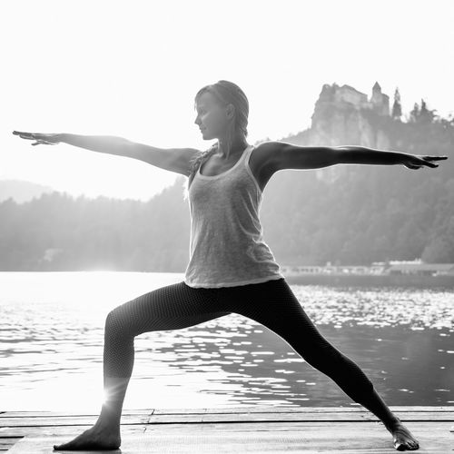 Doing yoga by the lake. Sun salutation Beautiful Black & White Hands Nature Open Arms Sunny Tranquility Warrior Woman Woman Power Yoga Yoga Pose Balance Black And White Lake Naturelovers One Person People Positive Vibes Sunshine Tranquil Scene Warrior Pose Water Waterfront Yoga Practice