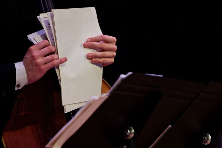 Jazz big band Arts Culture And Entertainment Black Background Close-up Holding Human Body Part Human Hand Indoors  Men One Person People Real People