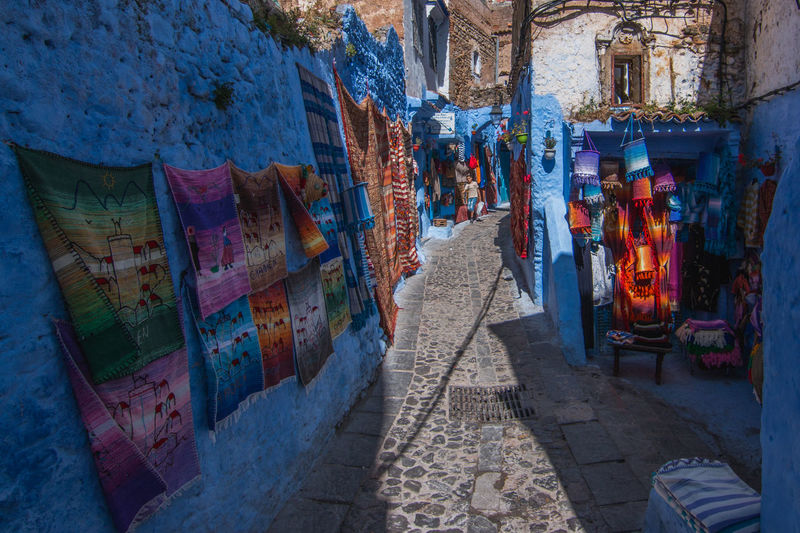 The carpet alley Africa Alley Architecture Blue Building Carpet Carpets Chefchaouen City Color Colorful Colors Culture Light Morocco Outdoors Street Sun Town Travel White
