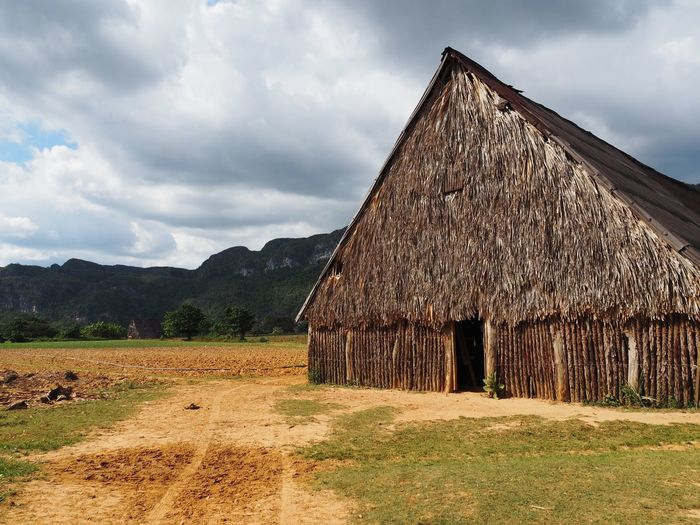 Sky Architecture Built Structure Cloud - Sky Landscape Building Exterior Land Nature Environment House Agricultural Building Hut Thatched Roof Building Mountain Barn Rural Scene Farm No People Roof Outdoors Cottage Tobacco Cigar Agriculture