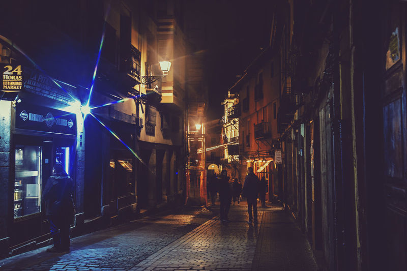 Night Architecture Building Exterior Illuminated Built Structure City Street Real People Walking Direction The Way Forward City Life Building Rear View People Lifestyles Leisure Activity Group Of People Nightlife Outdoors