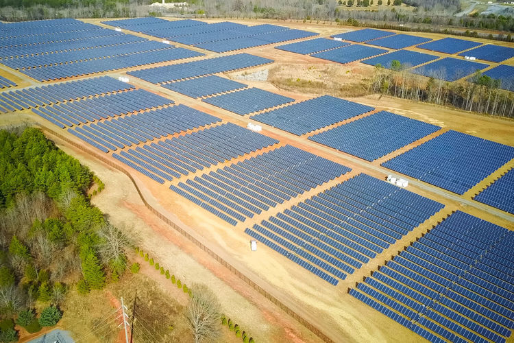 solar panels Solar Panel Solar Energy Alternative Energy Environment Renewable Energy Environmental Conservation Nature Fuel And Power Generation Land Technology Plant Field Landscape Day Agriculture Rural Scene Outdoors Aerial View In A Row High Angle View Electricity  Power Supply Solar Panels