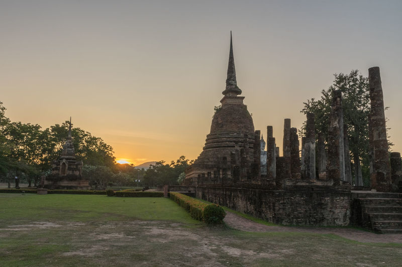 Ancient temples in sukhothai Buddha Buddhist Temple Architecture Built Structure Religion Building Exterior Place Of Worship Sky Belief History The Past Spirituality Building Sunset Travel Destinations Ancient Tourism Travel Nature Plant Ancient Civilization Outdoors Spire  Ruined Archaeology
