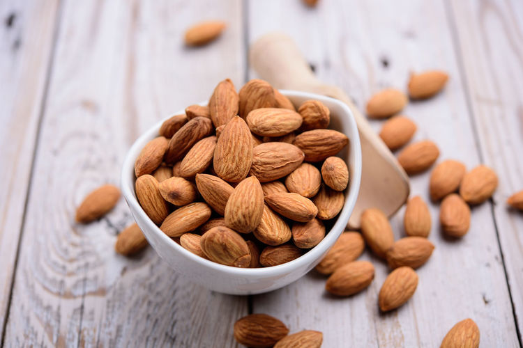 Food And Drink Food Almond Nut - Food Indoors  Nut Freshness Wellbeing Close-up Large Group Of Objects Table Brown Still Life Healthy Eating No People Focus On Foreground High Angle View Abundance Wood - Material Bowl Snack Vegetarian Food