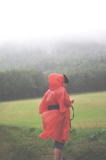 Rear view of a girl walking on field