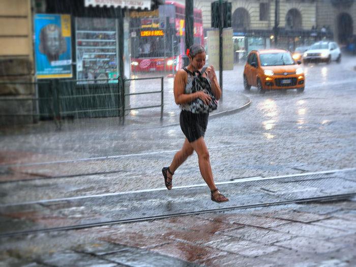 Full length of man on street in rain