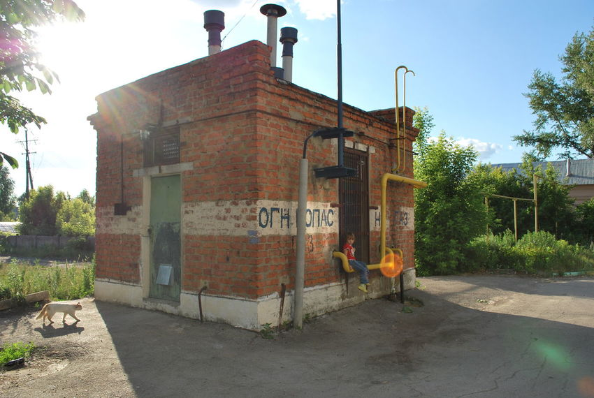 Architecture Building Exterior Built Structure Day Gas Station Outdoors Russian Landscapes Sky Summertime Tree Live For The Story BYOPaper! The Street Photographer - 2017 EyeEm Awards Dangerous Dangerous Places Gasstation Gas Sommergefühle