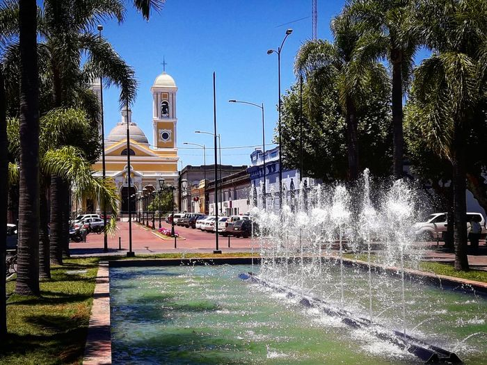 Minas/Uruguay Southamerica Natgeo Natgeotravel Plaza Lavalleja, Uruguay Discovery Minas Uruguay Fountain Church Spraying Water Built Structure Outdoors No People Architecture Palm Tree