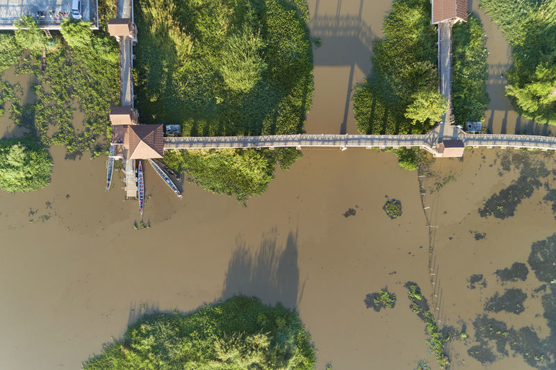 Aerial view of bridge over river during sunny day