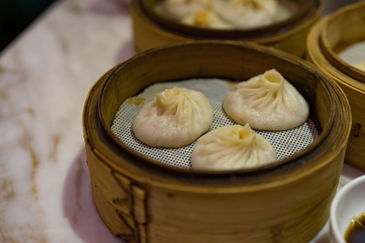 Food And Drink Food Freshness Dumpling  Container Asian Food Chinese Food Chinese Dumpling Wellbeing Still Life Dim Sum Close-up Ready-to-eat Indoors  Healthy Eating No People Basket Table High Angle View Steamed  Temptation Japanese Food