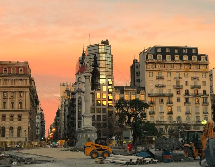Architecture Postmodernism Art Nouveau Eclectic Plaza Lavalle Tribunales Construction Worker Tractor Bulldozer Cityscape Architecture Building Exterior Built Structure Car Sunset Land Vehicle City Transportation Sky Outdoors Road Real People Cityscape Day