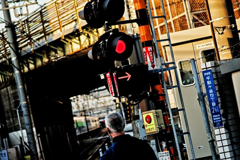 Railway Crossing Tokyo Tokyo,Japan Tokyo Street Photography City Street Photography City Street City Life Lifestyles Men Built Structure Hanging One Person Real People Building Exterior City