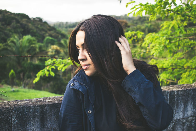 One Person Young Women Young Adult Real People Headshot Hair Long Hair Leisure Activity Portrait Tree Lifestyles Hairstyle Focus On Foreground Plant Nature Black Hair Beauty Women Beautiful Woman Outdoors Teenager Contemplation