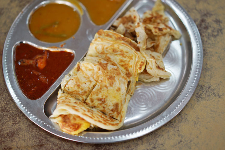 Roti Canai (Indian pancake) with curry sauce Close-up Day DIP Food Food And Drink Freshness Healthy Eating Indoors  Mexican Food No People Pita Bread Plate Ready-to-eat Stuffed Tortilla - Flatbread Wrap Sandwich