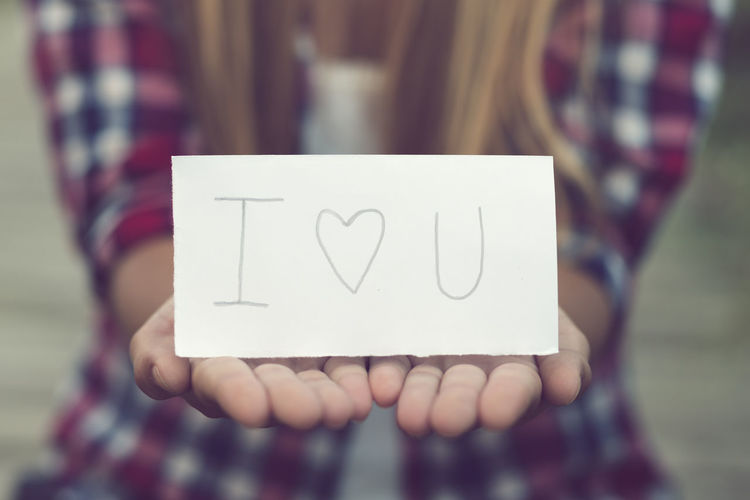 Woman's hands holding a paper where there is written I love you I Love U Valentine's Day  Close-up Communication Day Focus On Foreground Holding Human Hand I Love You Love Message One Person Outdoors Paper People Real People Text Woman Hand