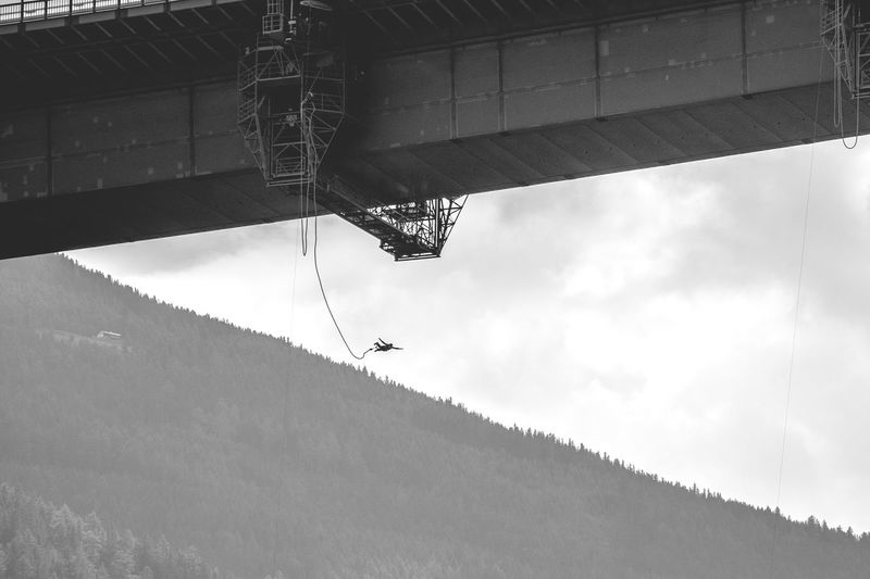Low angle view of bungee jumping
