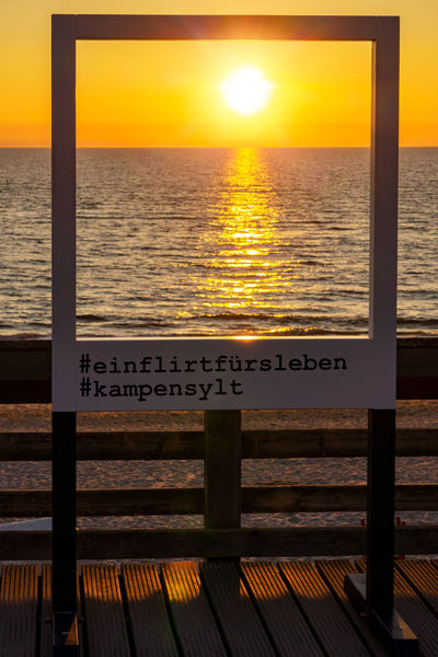 Sunset at Kampen Beach Kampen, Sylt Sonnenuntergang Sunset_collection Sylt, Germany Beauty In Nature Frame Horizon Horizon Over Water Nature No People Ocean Orange Color Outdoors Railing Scenics - Nature Sea Sky Sun Sunlight Sunset Sylt Water Wood - Material
