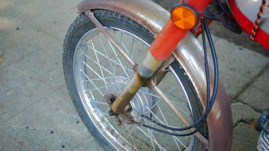 High angle view of bicycle wheel on street