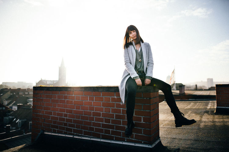 On the roooftops of Potsdam One Person Young Adult Architecture Casual Clothing Full Length Front View Day Building Exterior Looking At Camera Young Women Built Structure Sky Portrait Lifestyles Adult Leisure Activity Beautiful Woman Hairstyle Hair Outdoors Contemplation EyeEm Best Shots Rooftop Chimney 2018 In One Photograph EyeEmNewHere My Best Photo