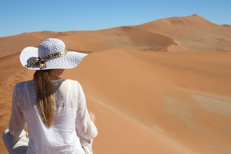Desolate Beautiful Nature Blonde Namibia Orange Sossusvlei Sossusvlei Desert - Namibia Woman Blonde Girl Blonde Hair Desert Landscape Leisure Activity Orange Colour Sand Sand Dune Sun Hat Sunhat Young Adult Young Woman